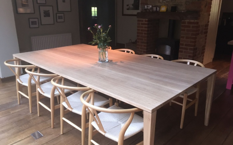 A contemporary tapered leg dining table