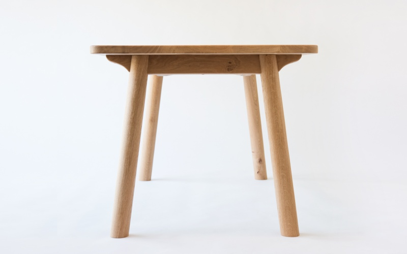 A contemporary turned leg dining table